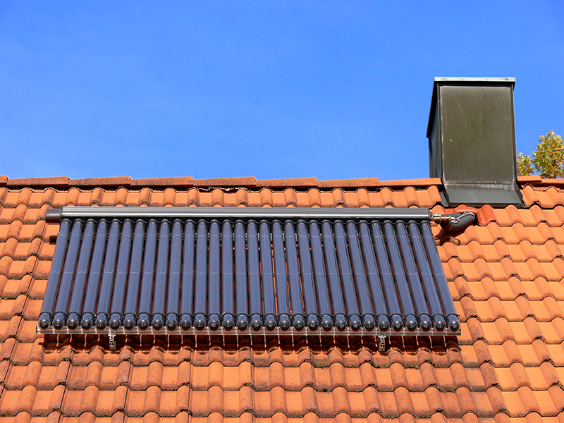 Evacuated Tube Solar Collector on Red Tile Roof